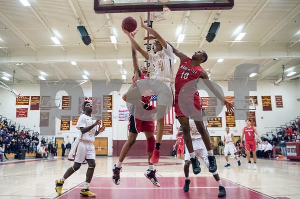 02/22/18 Wesley Bunnell | Staff New Britain boys basketball defeated Manchester 60-52 on Thursday night at New Britain High School. Jamani Eaton (4).