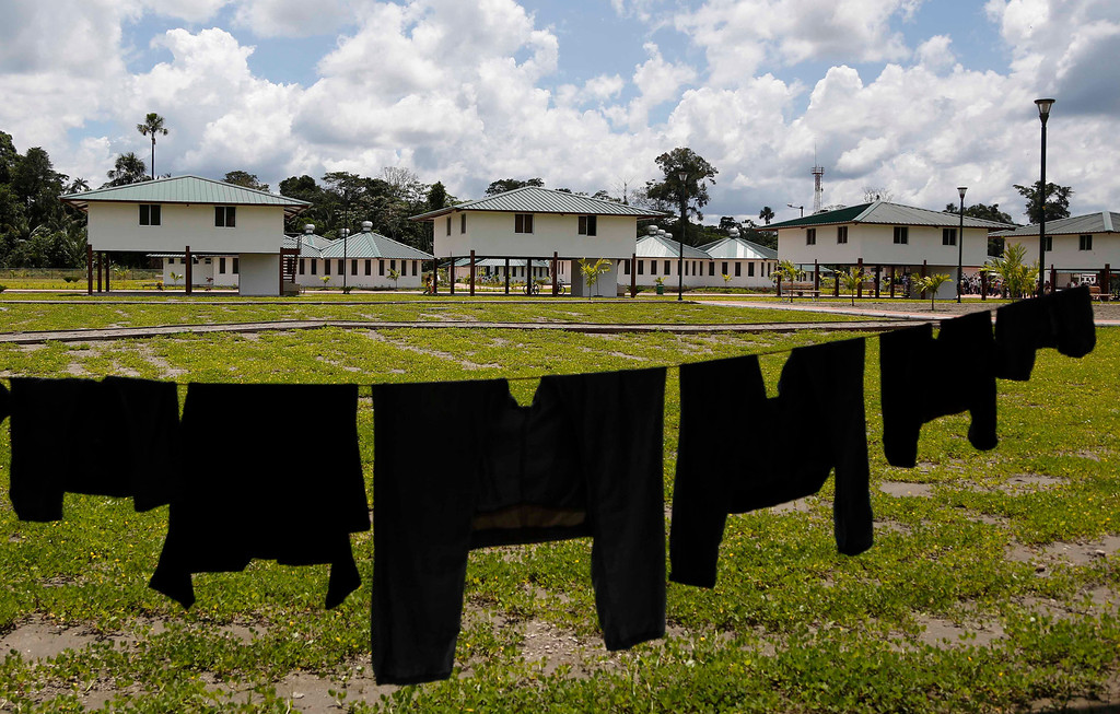 . In this Tuesday, Oct. 1, 2013 photo, clothes hang out to dry in the Amazonian village, Comunidad del Milenio, in Playas de Cuyabeno, Ecuador. The government inaugurated the village on Tuesday, built from the ground up, with infrastructure that includes homes, schools, a library, a clinic and a police force. The Sionas and Secoyas indigenous communities, who already lived in the area, moved into the new hamlet. (AP Photo/Dolores Ochoa)