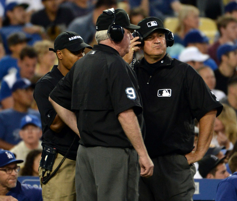 . Umpires wait for a decision on a instant replay call in the fourth inning of a Major league baseball game between the San Diego Padres and the Los Angeles Dodgers on Saturday, July 12, 2014 in Los Angeles.   (Keith Birmingham/Pasadena Star-News)