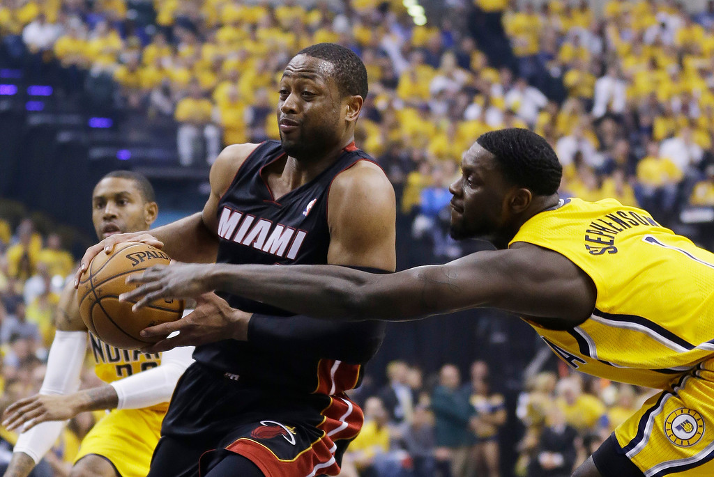 . Miami Heat\'s Dwyane Wade is defended by Indiana Pacers\' Lance Stephenson during the first half of Game 2 of the NBA basketball Eastern Conference finals in Indianapolis, Tuesday, May 20, 2014. (AP Photo/Michael Conroy)