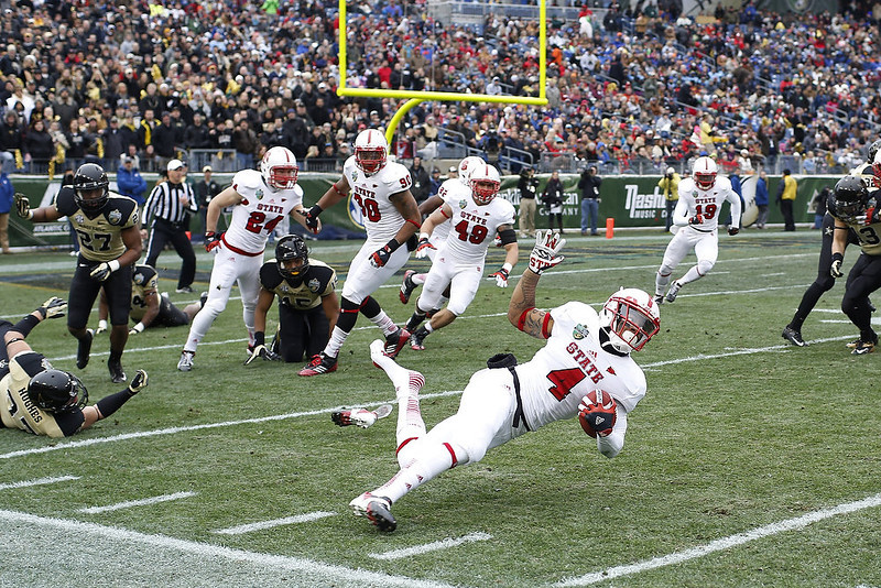 . Tobais Palmer #4 of the North Carolina State Wolfpack gets tripped up on a kick return against the Vanderbilt Commodores during the Franklin American Mortgage Music City Bowl at LP Field on December 31, 2012 in Nashville, Tennessee. (Photo by Joe Robbins/Getty Images)