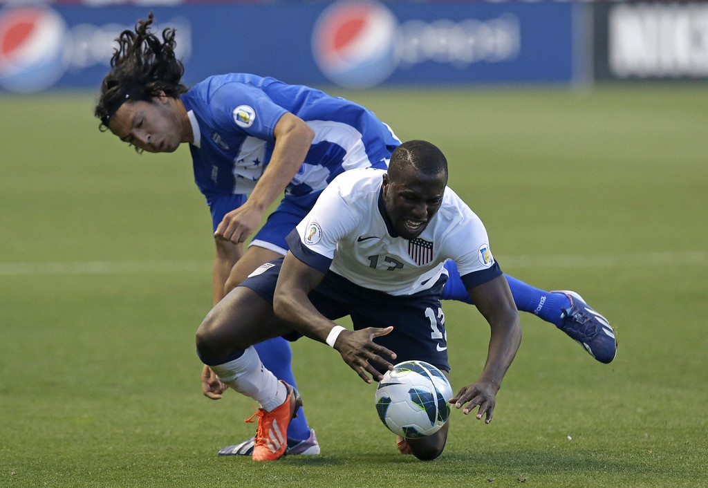 . United States\' Jozy Altidore (17) and Honduras\' Roger Espinoza battle for the ball in the second half during an World Cup qualifying soccer match at Rio Tinto Stadium on Tuesday, June 18, 2013, in Sandy, Utah. USA defeated Honduras 1-0. (AP Photo/Rick Bowmer)