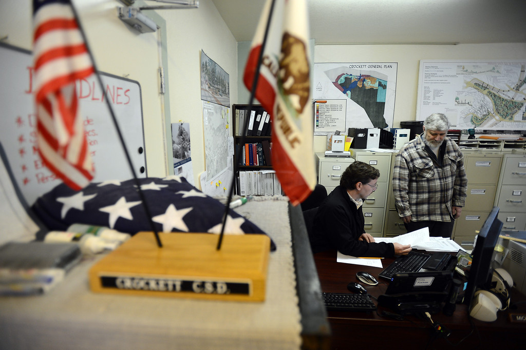 . Crockett Community Services District employee Michael Kirker, left, talks with resident Kent Peterson in the office in Crockett, Calif. on Tuesday, Jan. 15, 2013. (Kristopher Skinner/Staff)