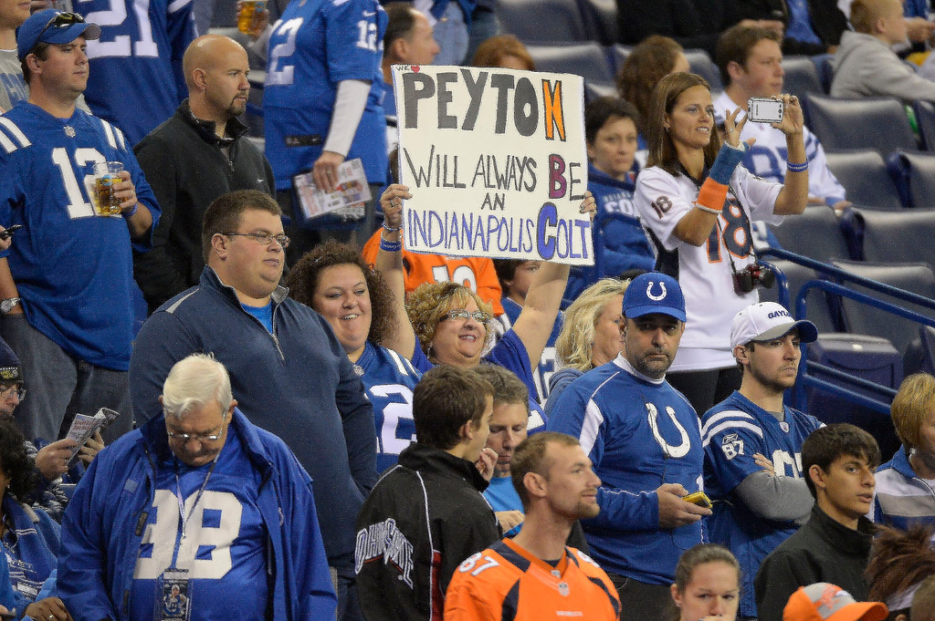 . Fans hold up signs before the Denver Broncos Indianapolis Colts game October 20, 2013 at Lucas Oil Field. Photo by John Leyba/The Denver Post)