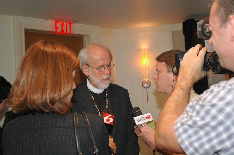 Presiding Bishop Mark Hanson answers questions from TV and radio reporters after the Aug. 8 press conference.