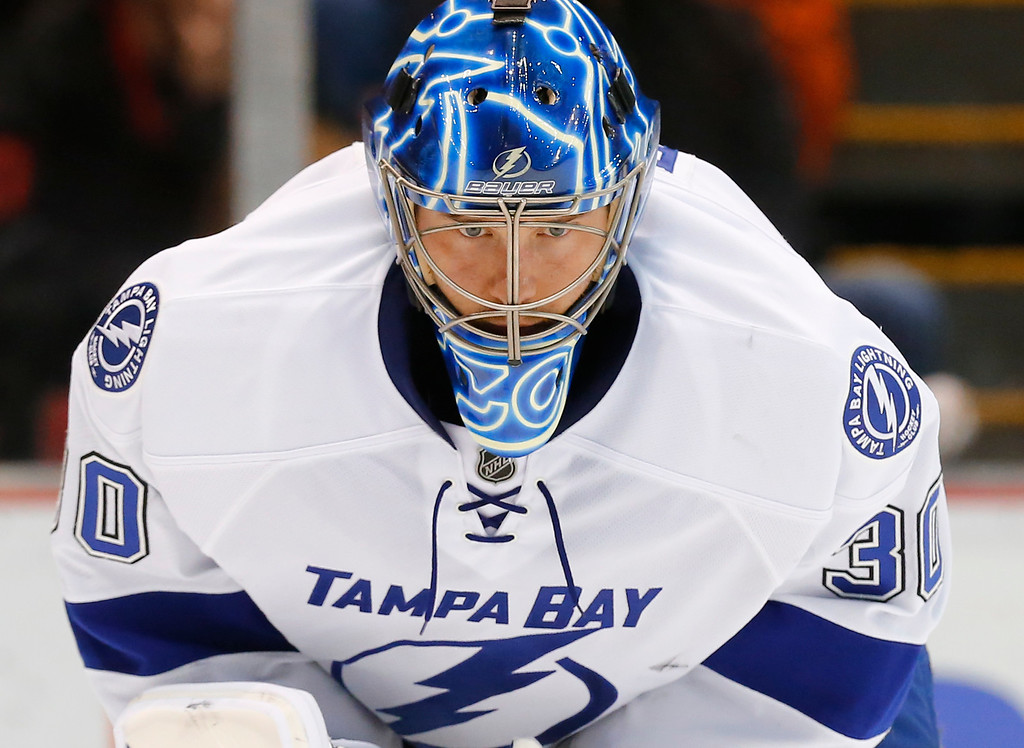 . Tampa Bay Lightning goalie Ben Bishop looks at the ice after allowing a goal by Detroit Red Wings\' Gustav Nyquist in the second period of an NHL hockey game in Detroit, Saturday, March 28, 2015. (AP Photo/Paul Sancya)