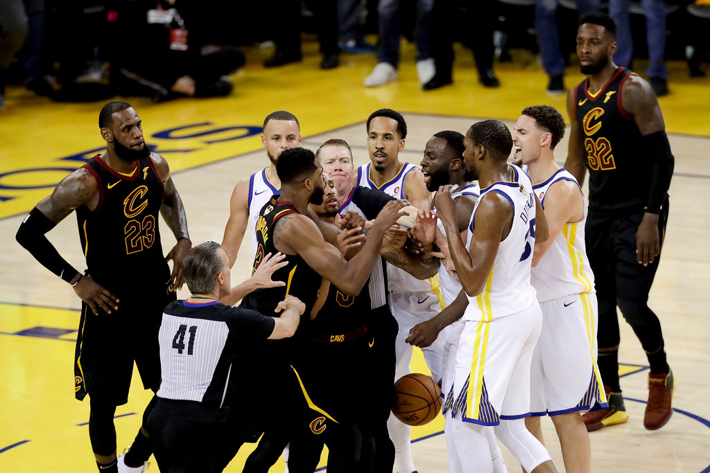 . An official tries to separate Cleveland Cavaliers center Tristan Thompson and Golden State Warriors forward Draymond Green during overtime of Game 1 of basketball\'s NBA Finals in Oakland, Calif., Thursday, May 31, 2018. The Warriors won 124-114. (AP Photo/Marcio Jose Sanchez)
