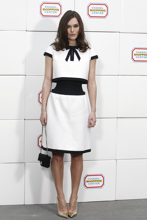 . Actress Keira Knightley poses as she arrives to Chanel\'s ready to wear fall/winter 2014-2015 fashion collection presented in Paris, Tuesday, March 4, 2014. (AP Photo/Thibault Camus)