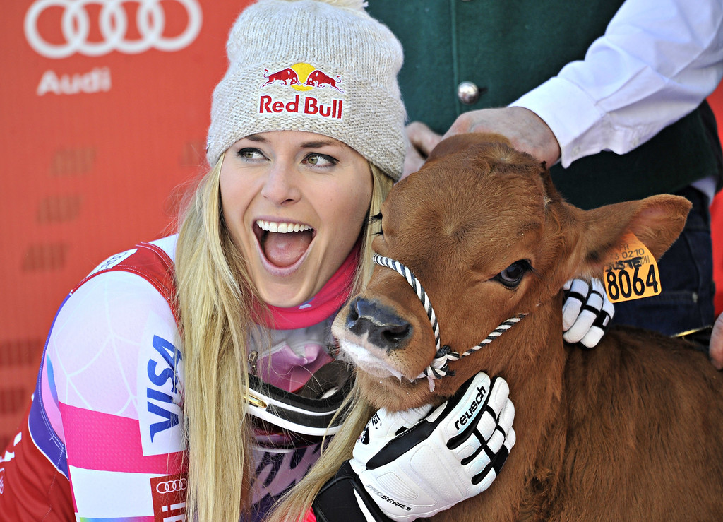 . Lindsey Vonn of the USA takes 1st place and wins a cow named Winny during the Audi FIS Alpine Ski World Cup Women\'s Downhill on December 20, 2014 in Val D\'isere, France.  (Photo by Michel Cottin/Agence Zoom/Getty Images)