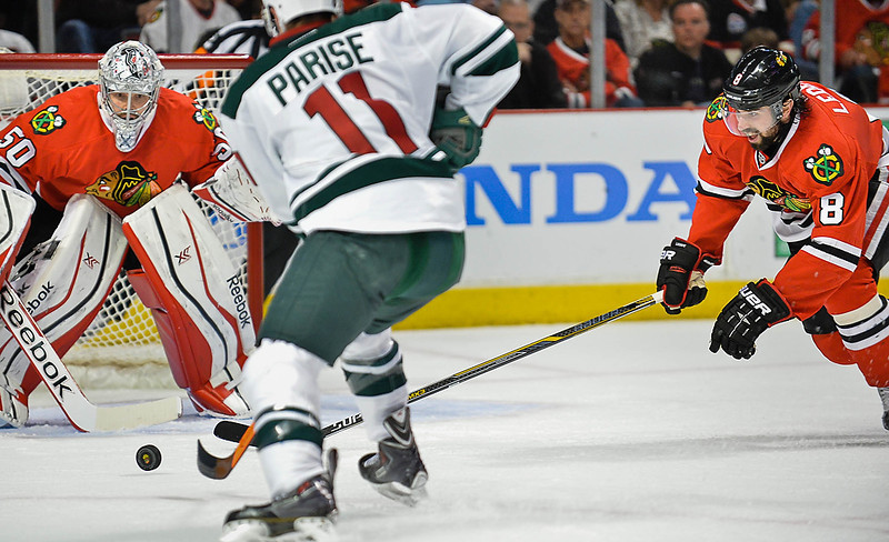 . Minnesota Wild left wing Zach Parise takes a shot on Chicago Blackhawks goalie Corey Crawford during the second period. At right is Chicago Blackhawks defenseman Nick Leddy.  Blackhawks won 2-1. (Pioneer Press: Ben Garvin)