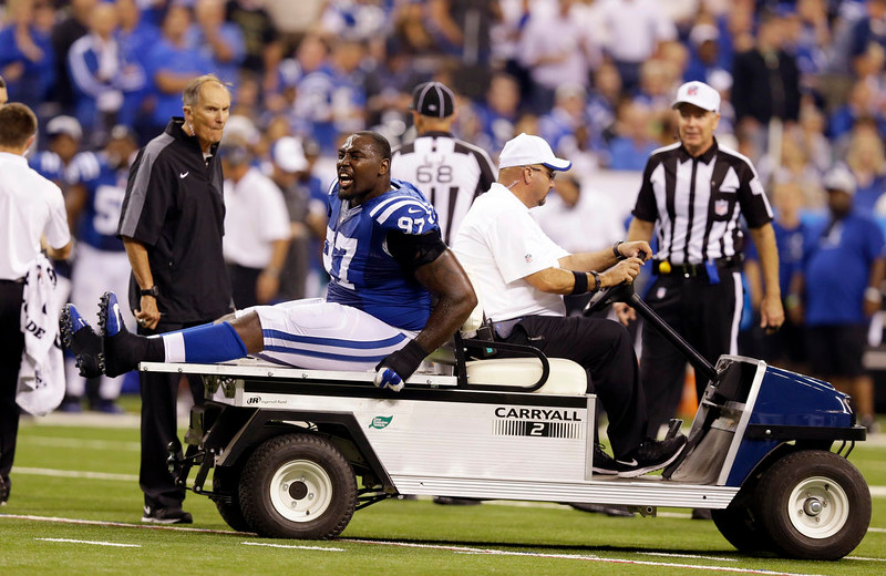 . Indianapolis Colts defensive end Arthur Jones (97) is carted off the field after getting injured during the first half of an NFL football game against the Philadelphia Eagles Monday, Sept. 15, 2014, in Indianapolis. (AP Photo/Michael Conroy)