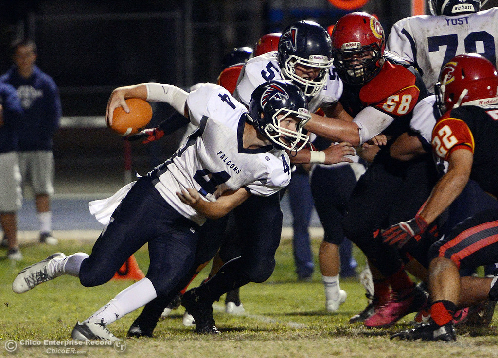 . Central Valley High\'s #4 Timmy Naylor rushes against Chico High in the first quarter of their football game at Asgard Yard Friday, September 27, 2013, in Chico, Calif.  (Jason Halley/Chico Enterprise-Record)