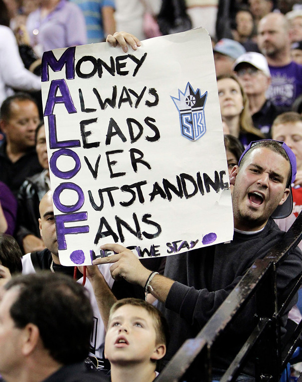 . A Sacramento Kings fan holds a sign during an NBA basketball game against the Los Angeles Clippers in Sacramento, Calif., Wednesday, April 17, 2013. (AP Photo/Rich Pedroncelli)