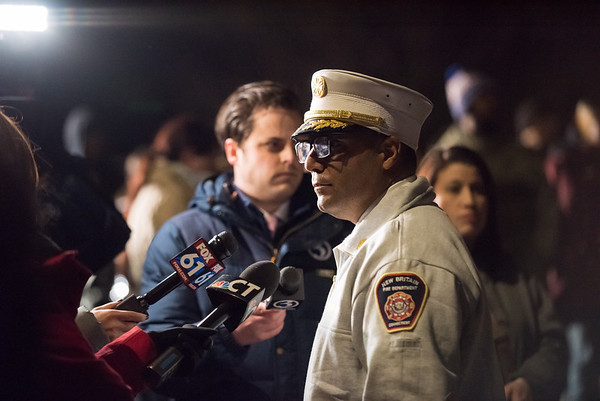 03/01/19 Wesley Bunnell | Staff A candlelight vigil was held on Friday night in front of 73 Elam St where fire claimed the lives of two men, 17 year old Elijah Little and his brother 29 year old Shaheen Davis. Fire Chief Raul Ortiz is interviewed.