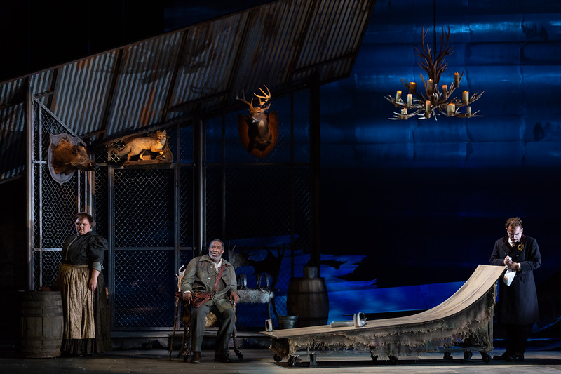 """L to R: Gretchen Krupp as Pasek's Wife, Eric Owens as the Forester, Dylan Morrongiello as the Schoolmaster in The Glimmerglass Festival's 2018 production of Janáček's """"The Cunning Little Vixen."""" Photo: Karli Cadel/The Glimmerglass Festival"""