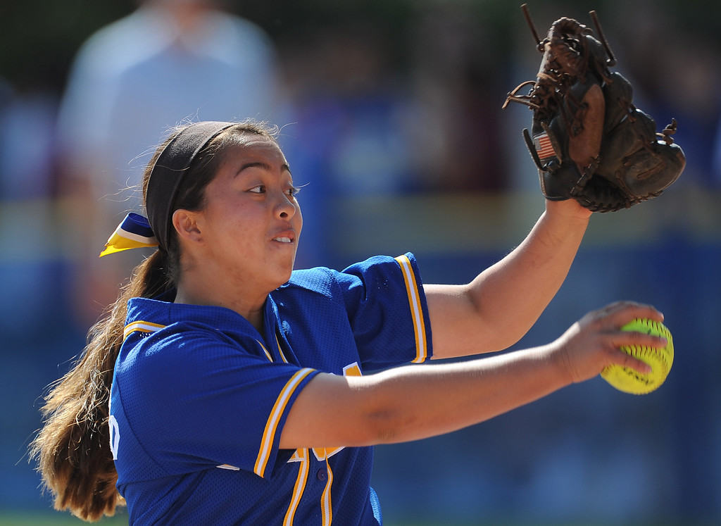 . Bishop Amat starting pitcher Sabrina Anguiano throws to the plate in the first inning of a prep softball game against Santiago at Bishop Amat High School on Wednesday, March 27, 2013 in La Puente, Calif. Bishop Amat won 5-3.  (Keith Birmingham Pasadena Star-News)