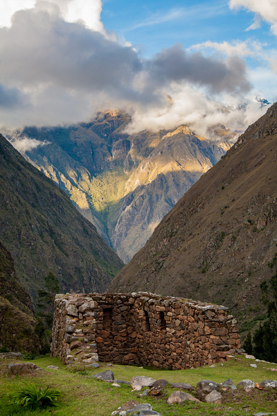 Ancient Incan ruins in front of a high valley in Peru
