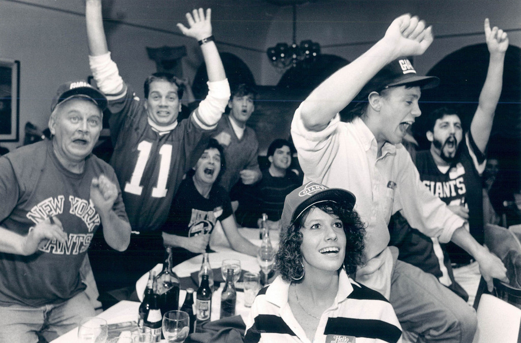 . JAN 26 1987 - Giants fans went crazy at Little Pepina\'s as their team won. L to R are Arthur LeBel, his son Stephen Le Bel, 26 son John LeBel, 21 and his girldreind Debbie Greene 21. The Le Bels are originally from NY and have lived in Denver 9yrs. (Susan Biddle/The Denver Post)