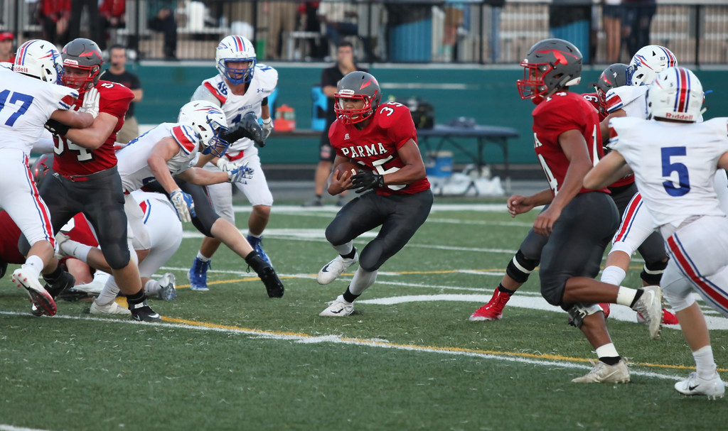 . Randy Meyers - The Morning Journal<br> Parma\'s Dominic DeArman runs through a huge hole in the Bay defense for a gain during the second quarter on Sept. 13.