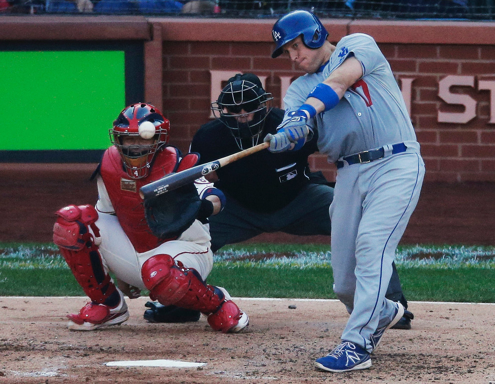 . Los Angeles Dodgers\' A.J. Ellis hits a double during the fifth inning of Game 2 of the National League baseball championship series against the St. Louis Cardinals Saturday, Oct. 12, 2013, in St. Louis. (AP Photo/Chris Carlson)