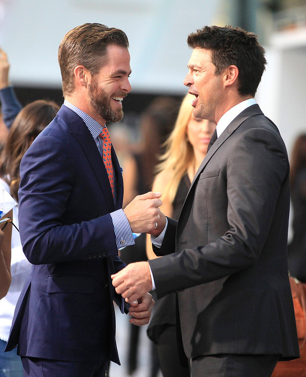 """. Actors Chris Pine (L) and Karl Urban, cast members of the new film \""""Star Trek Into Darkness\"""", greet each other as they arrive at the film\'s premiere in Hollywood May 14, 2013. REUTERS/Fred Prouser"""