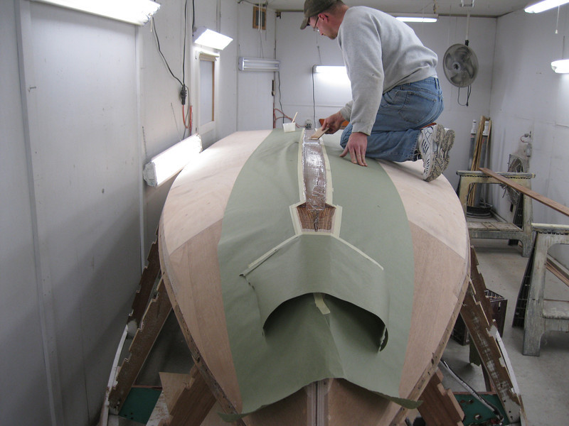 Front view of epoxy being applied to install keel cap.