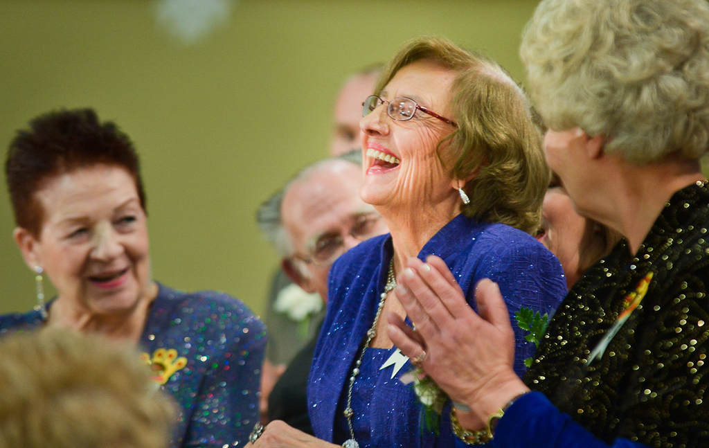 . Gerry Schulz, center, reacts after she was revealed as this year\'s Queen of the Northlands during the Senior Royalty Coronation ceremony.  (Pioneer Press: Ben Garvin)
