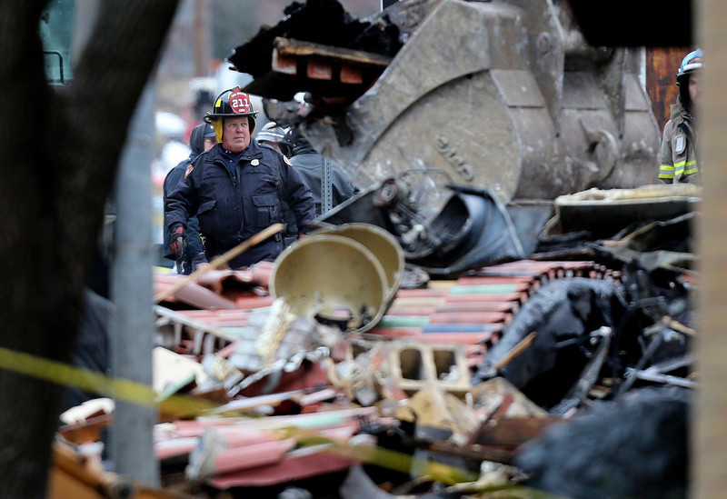 . A Kansas City Missouri firefighters walks through the rubble of JJ\'s restaurant after an explosion and fire tore through the establishment Tuesday evening near the Country Club Plaza Wednesday, Feb. 20, 2013, in Kansas City, Mo. One person was killed and injuring over a dozen. (AP Photo/Ed Zurga)