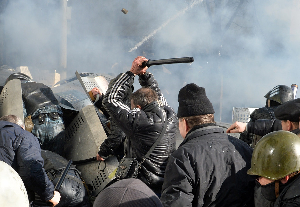 . Anti-government protesters clash with police in the center of  Kiev on February 18, 2014. Police on Tuesday fired rubber bullets at stone-throwing protesters as they demonstrated close to Ukraine\'s parliament in Kiev, an AFP reporter at the scene said. Police also responded with smoke bombs after protesters hurled paving stones at them as they sought to get closer to the heavily-fortified parliament building. AFP PHOTO/ SERGEI  SUPINSKY/AFP/Getty Images