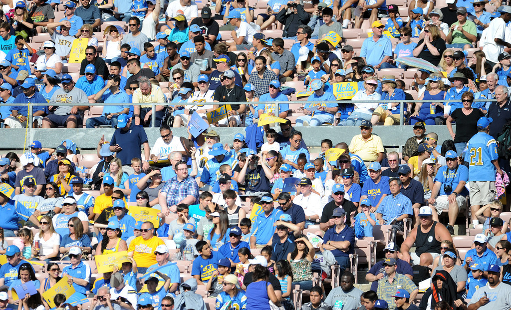 . UCLA fans watch the football spring showcase college football game in the Rose Bowl on Saturday, April 27, 2013 in Pasadena, Calif.    (Keith Birmingham Pasadena Star-News)