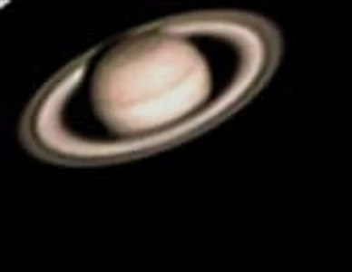 This is one of my 1st. Photos of Saturn. I took this photo using a ext 125 and a sac 7 ccd in auto mode, that is why it looks pink.