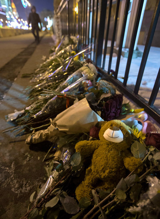 . Flowers and toys lay near the U.S. Embassy in Moscow, Russia, Saturday, Dec. 15, 2012.  The massacre of 26 children and adults at Sandy Hook Elementary school elicited horror and soul-searching around the world even as it raised more basic questions about why the gunman, 20-year-old Adam Lanza, would have been driven to such a crime and how he chose his victims. (AP Photo / Misha Japaridze)
