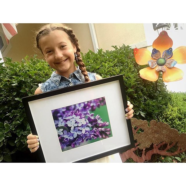 Two years running and her lilacs photo is still the best seller. Thank you to EVERYONE near and far who came out to support @kaylakat25 in the Port Clinton Art Fair this weekend!