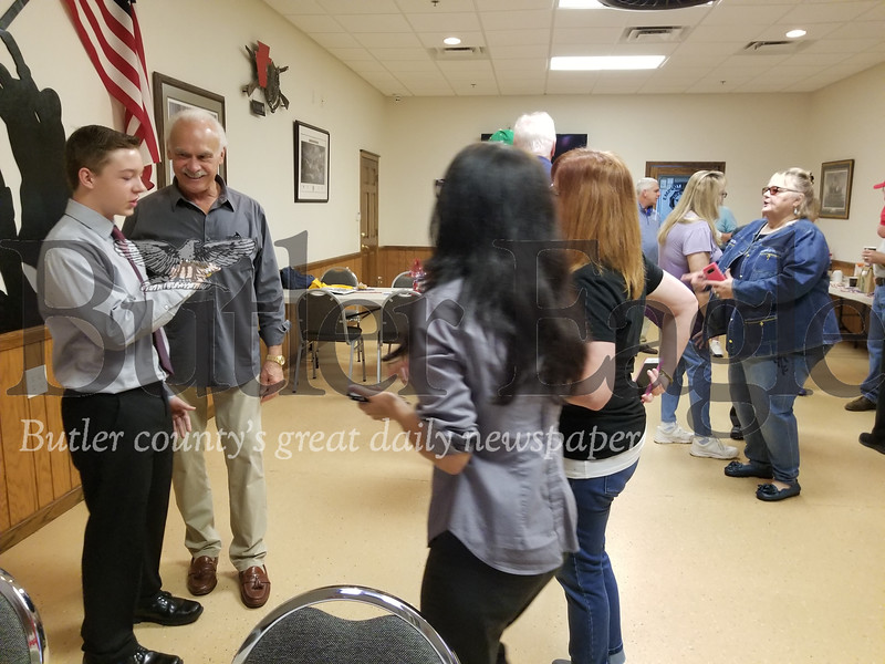 Former Steeler half back Rocky Bleier (right) loaned Isaac Pawlowicz, 11, of Connoquenessing Township (left) his championship rings for photograph at an event for U.S. Rep. Mike Kelly on Saturday at the American Legion 778 in Lyndora.