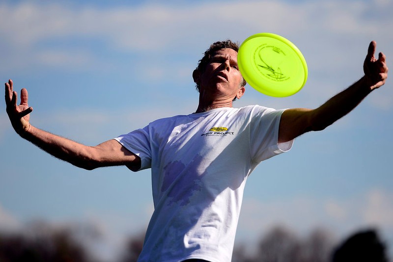 . Larry Imperiale plays freestyle frisbee with Jonathan Willett at Washington Park. Temperatures reached the low 80s in Denver. (Photo by AAron Ontiveroz/The Denver Post)