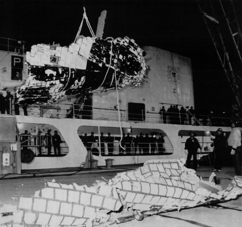 . Workers remove a large section of the space shuttle Challenger from the USCG Cutter Dallas. Being lowered is the right lower section of the forward fuselage that surrounded a portion of the crew compartment. On deck is what is believed to be another portion of the fuselage.  Denver Post Library Archive