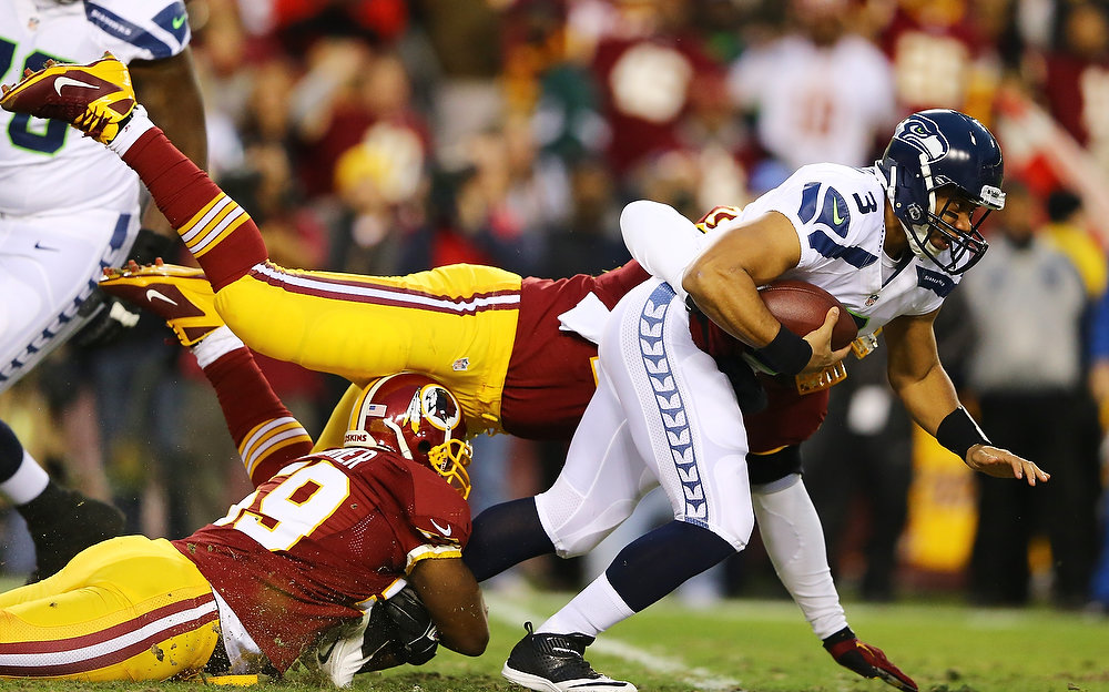 . Russell Wilson #3 of the Seattle Seahawks is sacked by the Washington Redskins in the first quarter of the NFC Wild Card Playoff Game at FedExField on January 6, 2013 in Landover, Maryland.  (Photo by Al Bello/Getty Images)