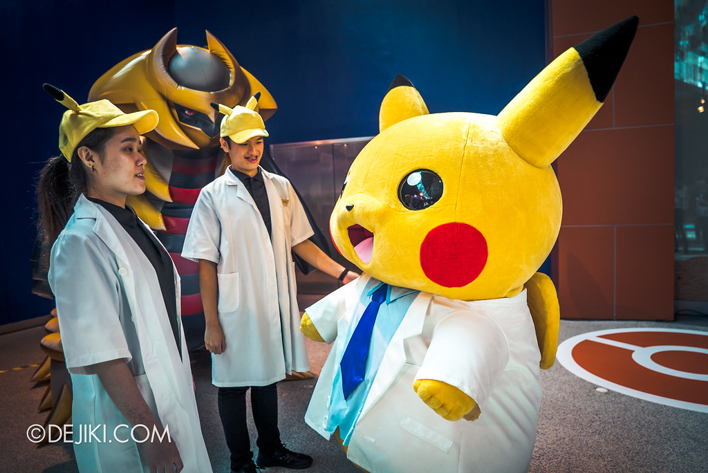 Pokémon Research Exhibition Launch -  Professor Pikachu having a casual chat with researchers