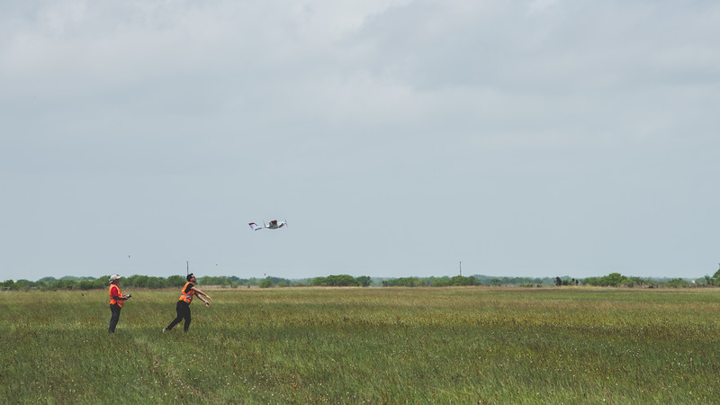Pilot in command Maurice Griffin(left) and visual observer Daniel Mendez launch the PrecisionHawk Lancaster during the Lone Star UAS launch in Port Mansfield, Tx.