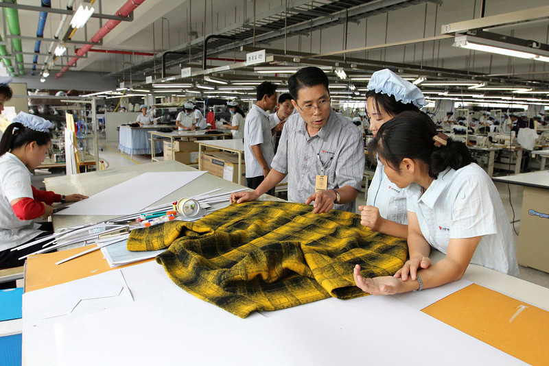 . In this Sept. 21, 2012 photo, a South Korean manager consults with North Korean workers preparing to produce clothing at the South Korean-run ShinWon Corp. garment factory inside the Kaesong industrial complex in Kaesong, North Korea. On Wednesday, April 3, 2013, North Korea refused entry to South Koreans trying to cross the Demilitarized Zone to get to their jobs managing factories in the North Korean city of Kaesong. Pyongyang had threatened in recent days to close the border in anger over South Korea\'s support of U.N. sanctions punishing North Korea for conducting a nuclear test in February. (AP Photo/Jean H. Lee)
