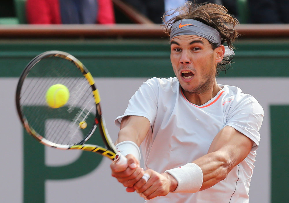 . Spain\'s Rafael Nadal returns against Japan\'s Kei Nishikori defeating him in three sets 6-4, 6-1, 6-3, in their fourth round match at the French Open tennis tournament, at Roland Garros stadium in Paris, Monday June 3, 2013. (AP Photo/Michel Euler)