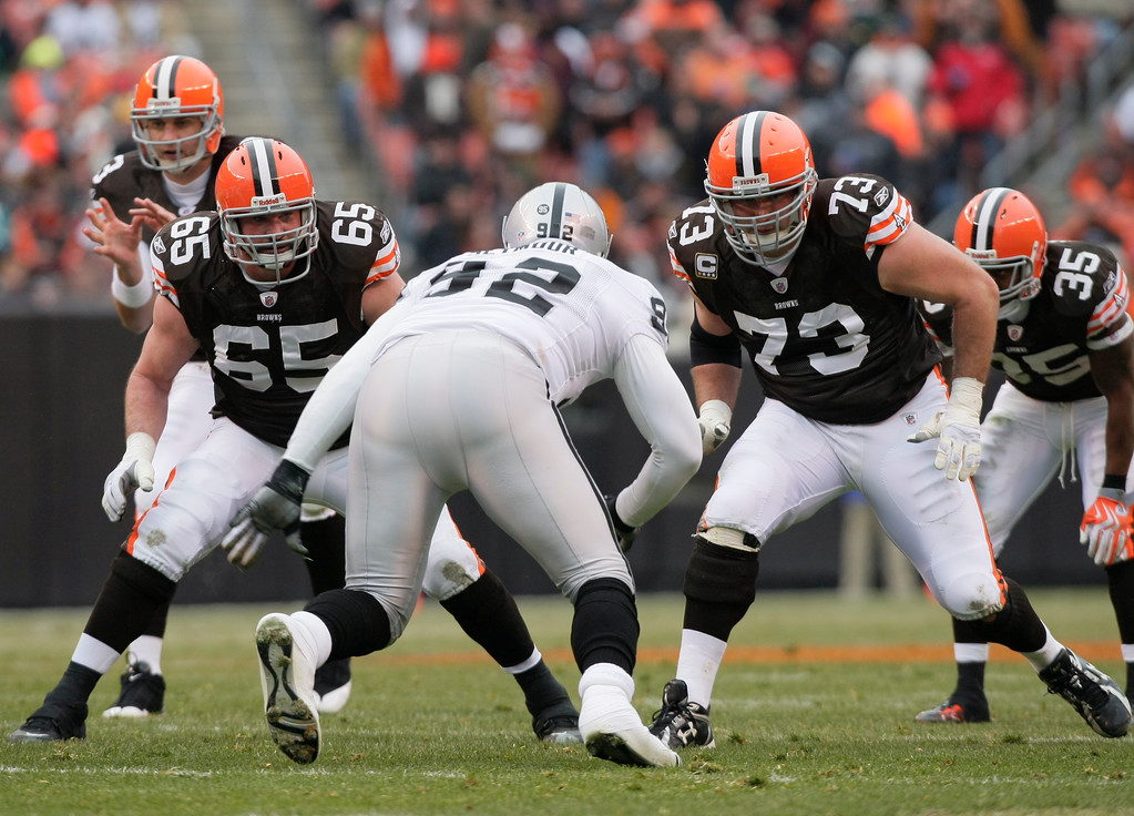 . Cleveland Browns guard Eric Steinbach (65) and offensive tackle Joe Thomas (73) take on Oakland Raiders defensive end Richard Seymour (92) in an NFL football game Sunday, Dec. 27, 2009, in Cleveland. (AP Photo/Mark Duncan)