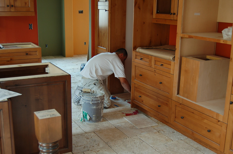 Laying tile in the kitchen.