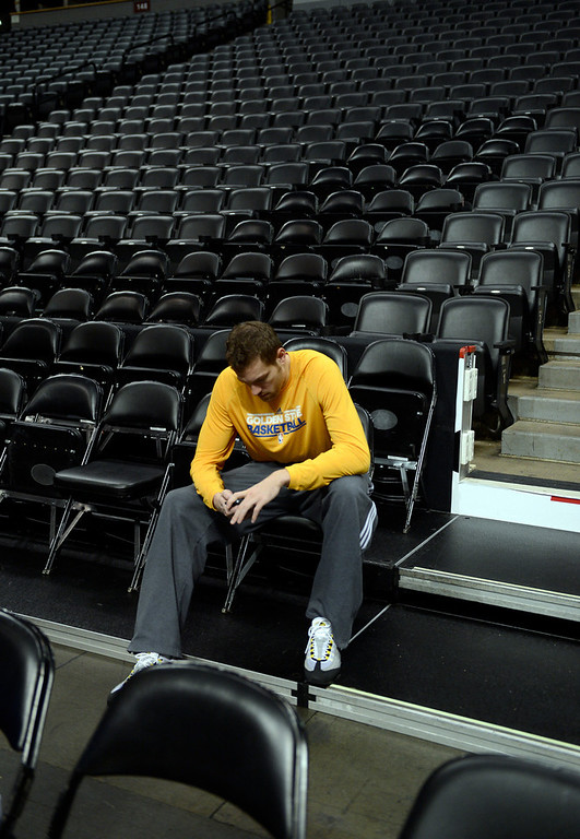 . David Lee (10) of the Golden State Warriors sits alone in the stands during practice April 22, 2013 at Pepsi Center. Lee is out for the season after tearing his right hip flexor during Golden State\'s 97-95 loss to Denver in Game 1 of their opening playoff series.The Golden State Warriors prepare for game two of the first round of the NBA playoffs against the Denver Nuggets. (Photo By John Leyba/The Denver Post)