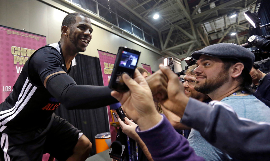 . Team West\'s Chris Paul, of the Los Angeles Clippers, shakes hands during a media availability at NBA All-Star game basketball practice in New Orleans, Saturday, Feb. 15, 2014. (AP Photo/Gerald Herbert)