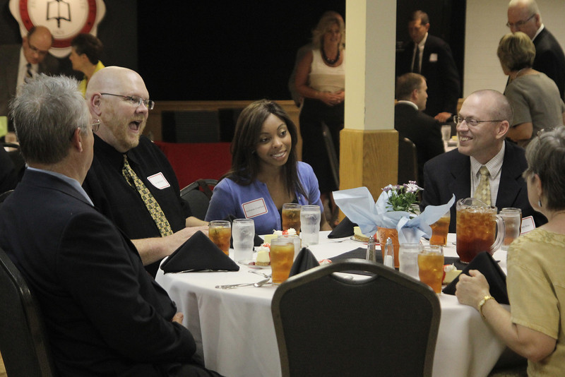 VerRhonda Crawford's most influential GWU staff/faculty member, Dr. Bob Carey interacts with other staff members before the ceremony