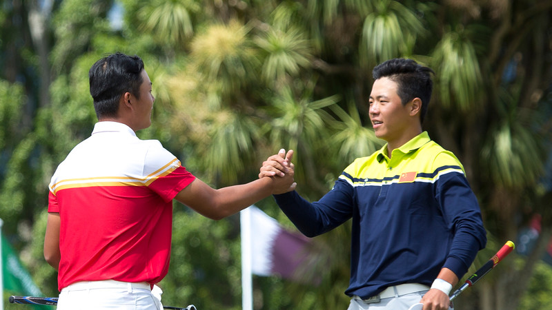 Yuxin Lin from China  (left) is congratulated by fellow countryman Andy Zhang on winning the Asia-Pacific Amateur Championship tournament 2017 held at Royal Wellington Golf Club, in Heretaunga, Upper Hutt, New Zealand from 26 - 29 October 2017. Copyright John Mathews 2017.   www.megasportmedia.co.nz