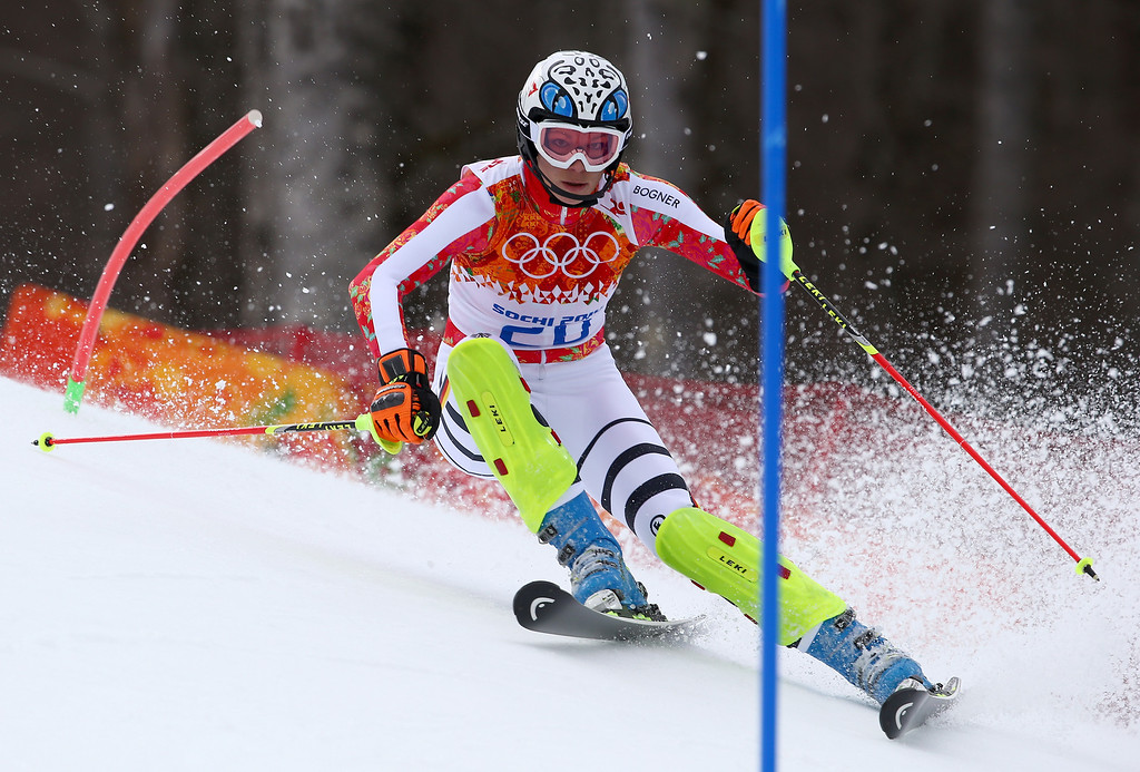. Germany\'s Maria Hoefl-Riesch passes a gate in the slalom portion of the women\'s supercombined to win the gold medal in the Sochi 2014 Winter Olympics, Monday, Feb. 10, 2014, in Krasnaya Polyana, Russia.(AP Photo/Alessandro Trovati)