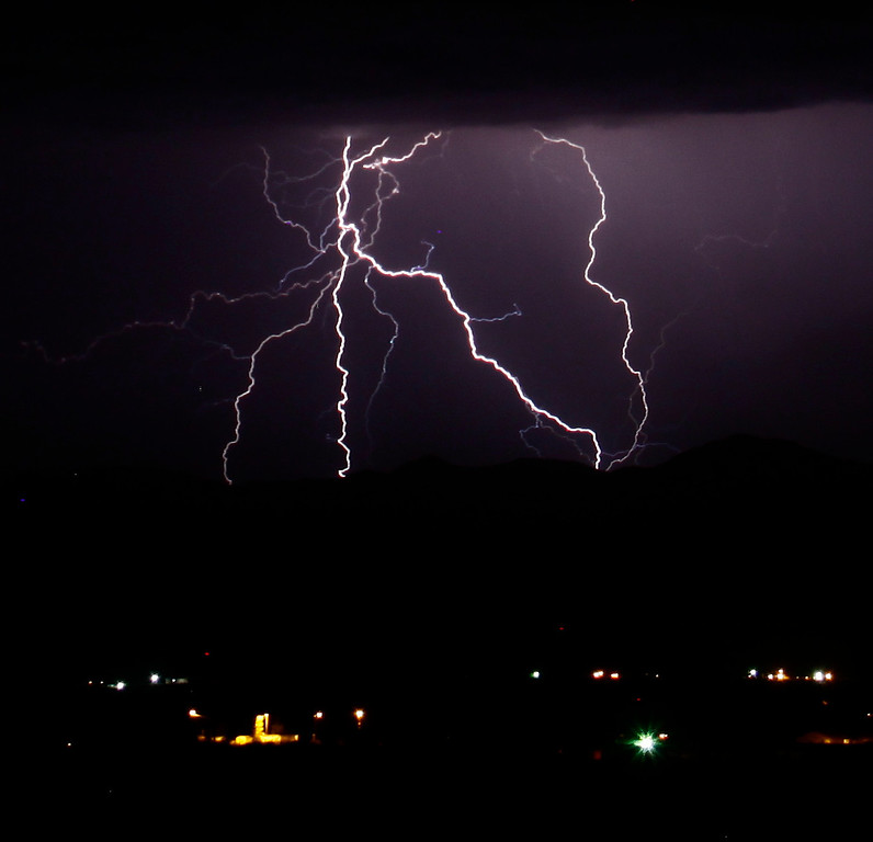 . Lightning strikes across the skies  Saturday evening into early Sunday morning  over Golden Valley AZ ,July 20. This monsoon storms the last two days has causes some major flooding and power outage in Las Vegas areas. July 20, ,2013. Photo by Gene Blevins/LA DailyNews