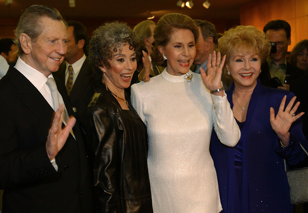 ". Cast members of the film ""Singin\' in the Rain,\"" from left, Donald O\'Connor, Rita Moreno, Cyd Charisse, and Debbie Reynolds, strike a pose from a musical number at a 50th Anniversary screening of the film in Beverly Hills, Calif., Thursday, Sept. 5, 2002. (AP Photo/Lucy Nicholson)"